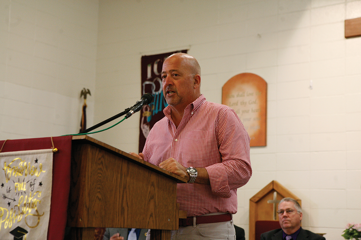 Reality TV host Andrew Zimmern giving a speech
