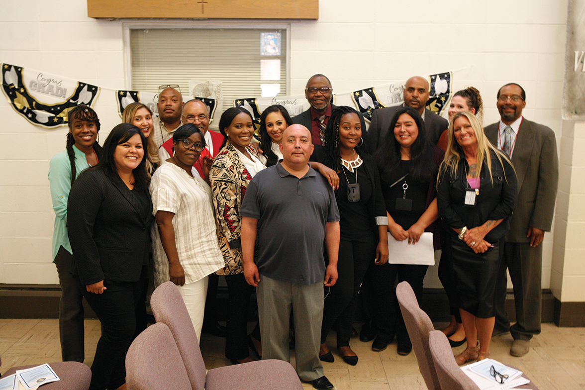 Center Point staff smile after the graduation