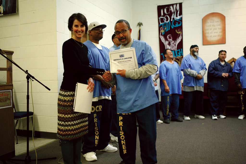 Michael W. Davis getting his certificate