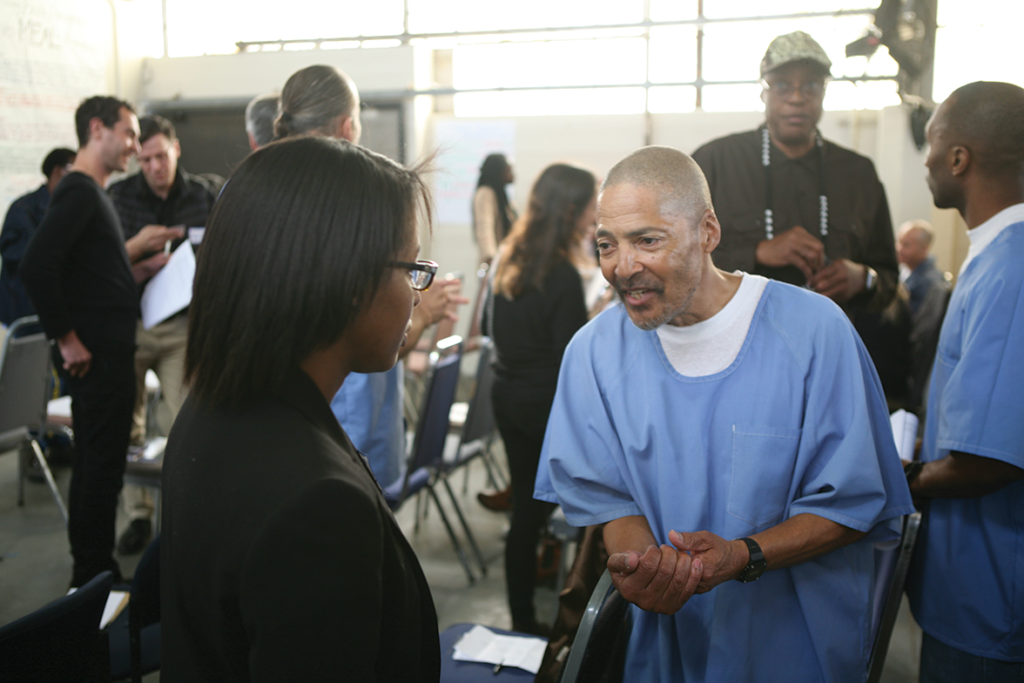 Volunteers and inmates exchanging ideas