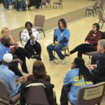 Participants sitting in a small circle share their personal experiences in the San Quentin Protestant Chapel