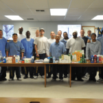 Kid CAT members with hygiene products donated from the residents of San Quentin for Huckleberry Youth Multi-Service Center