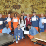 Options facilitators (in-blue), Kathy Narasaki, Tom Gorham and reception graduates holding their certificates