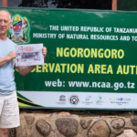 SQN Donor Jeff Marcous of White Salmon, Washington in Tanzania with the paper