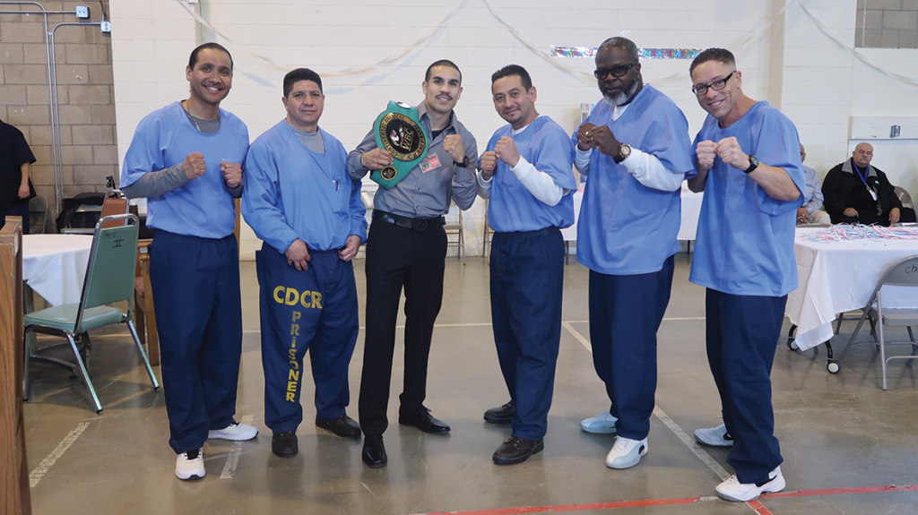 WBC super featherweight champion Andy Vences with facilitators and participants of the YOP program