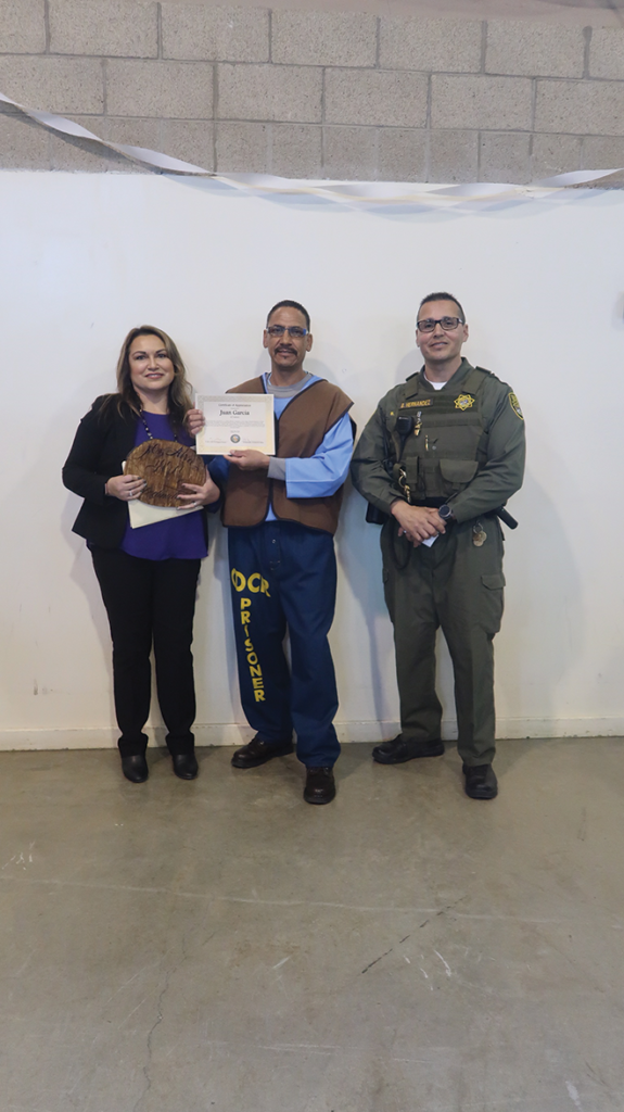 E. Alva, Juan Garcia and YOP Resource Officer B. Hernandez