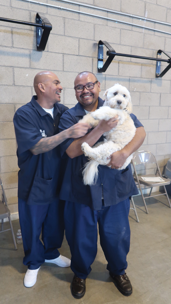 Inmate dog trainers with Bella