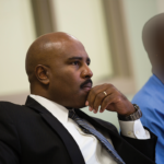 Keith Wattley sitting with a client for a hearing