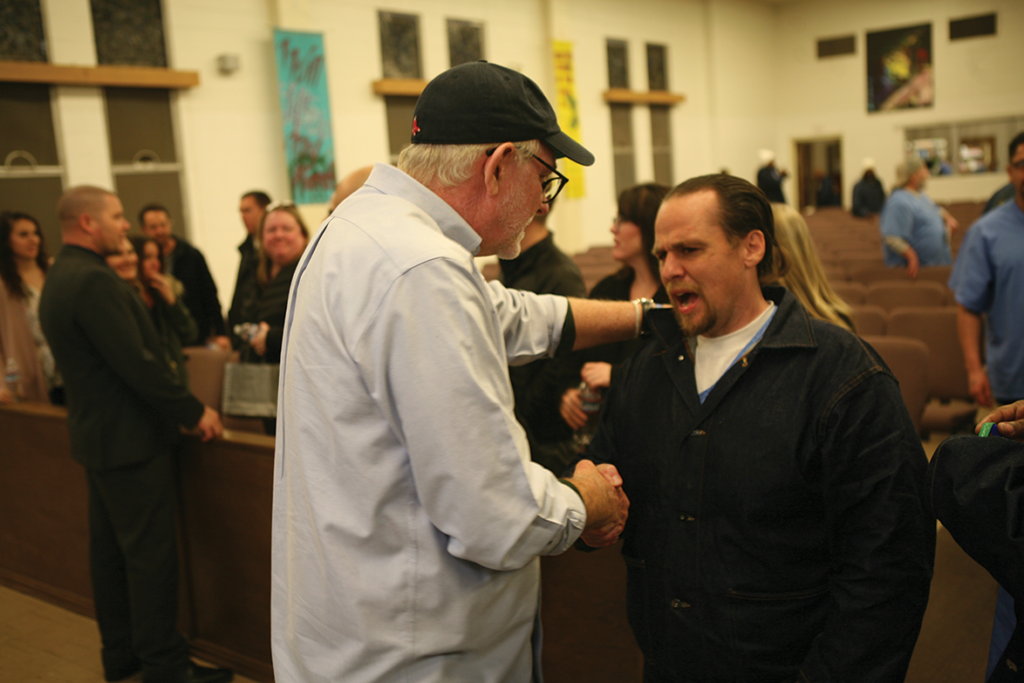 Goff speaking with a participant after the event