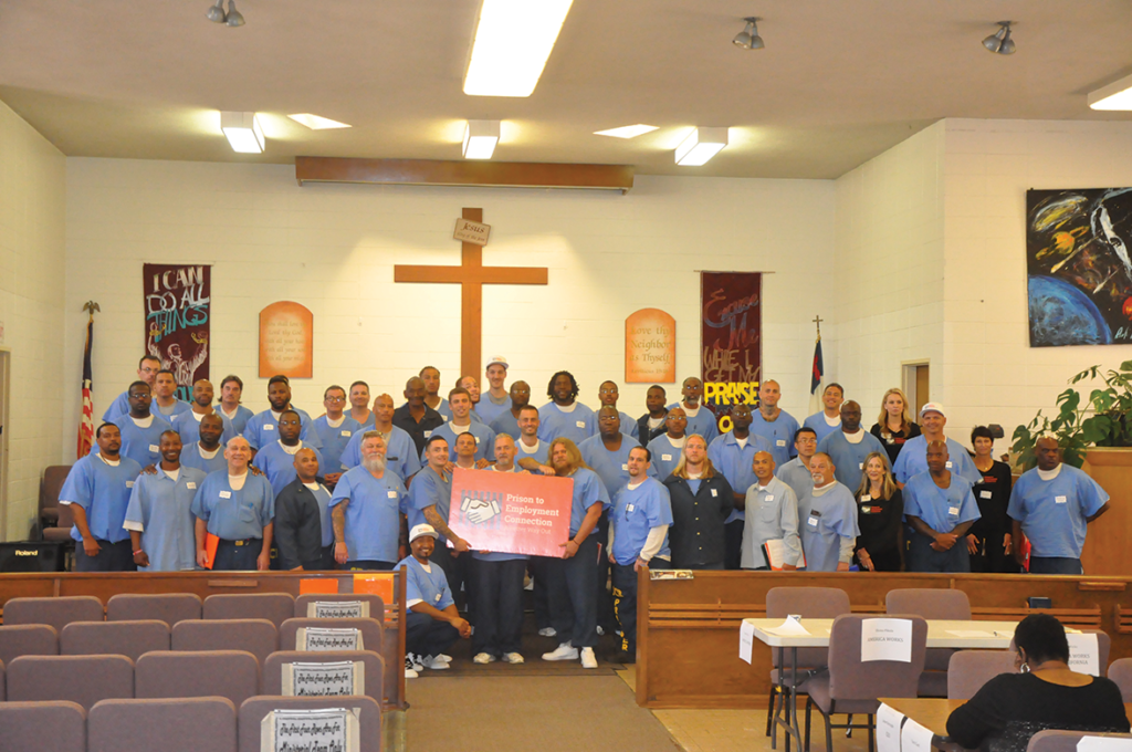 Prison to Employment Connection graduates and volunteers