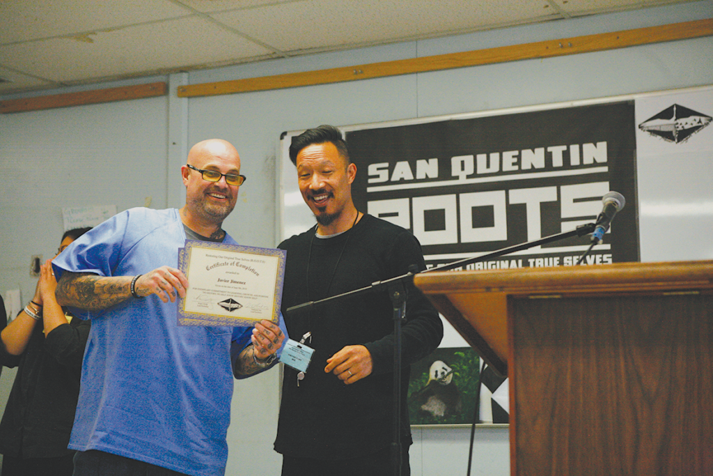 Roots graduate Javier Jimenez and Roger Chung