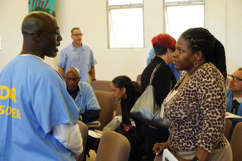 Participant Arthur Jackson speaking with a District Attorney