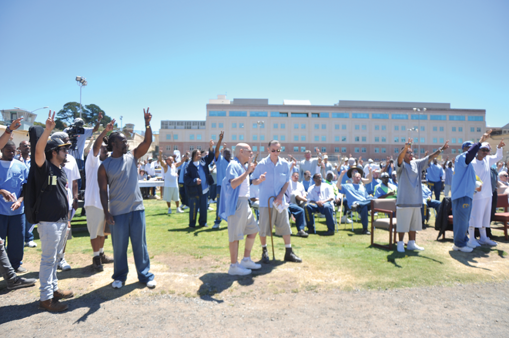 Participants raising the peace sign at high noon for the moment of silence