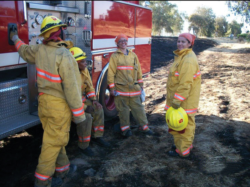 Amita Mota (center) with her fellow firefighters
