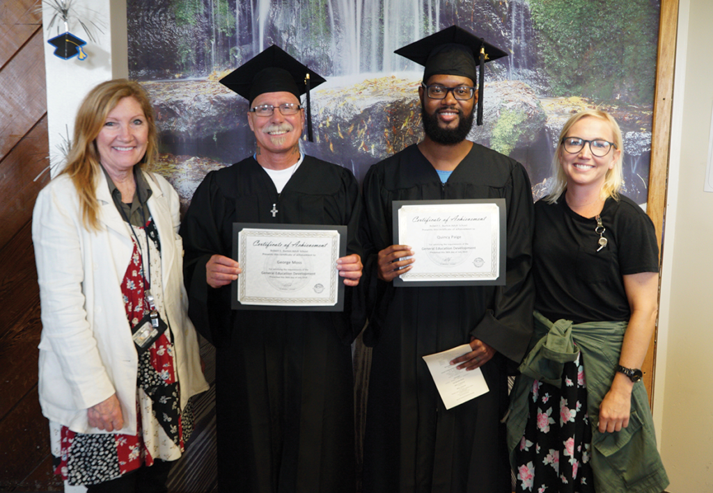 Educator D. Searle and H. Lucas with Graduate George Moss and Graduate Quincy Paige