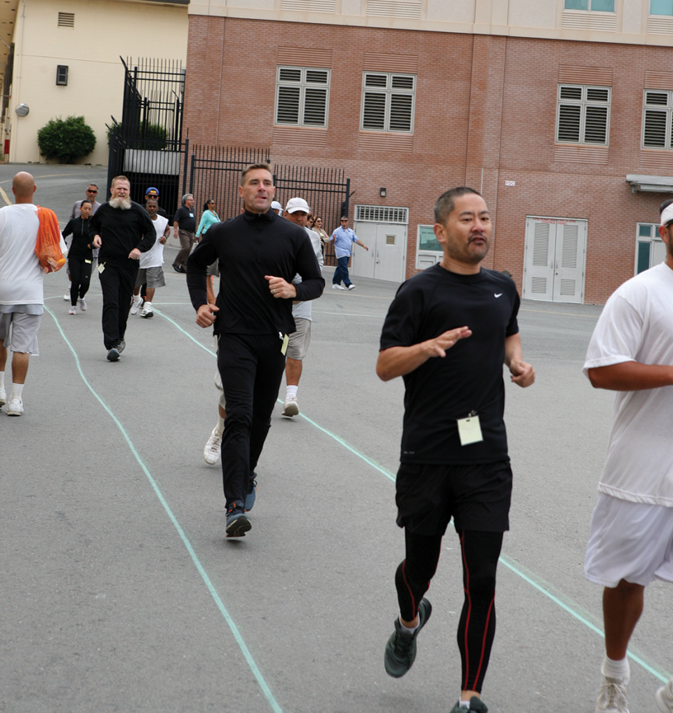 Phillip Peng with the Skid Row runners on the Lower Yard