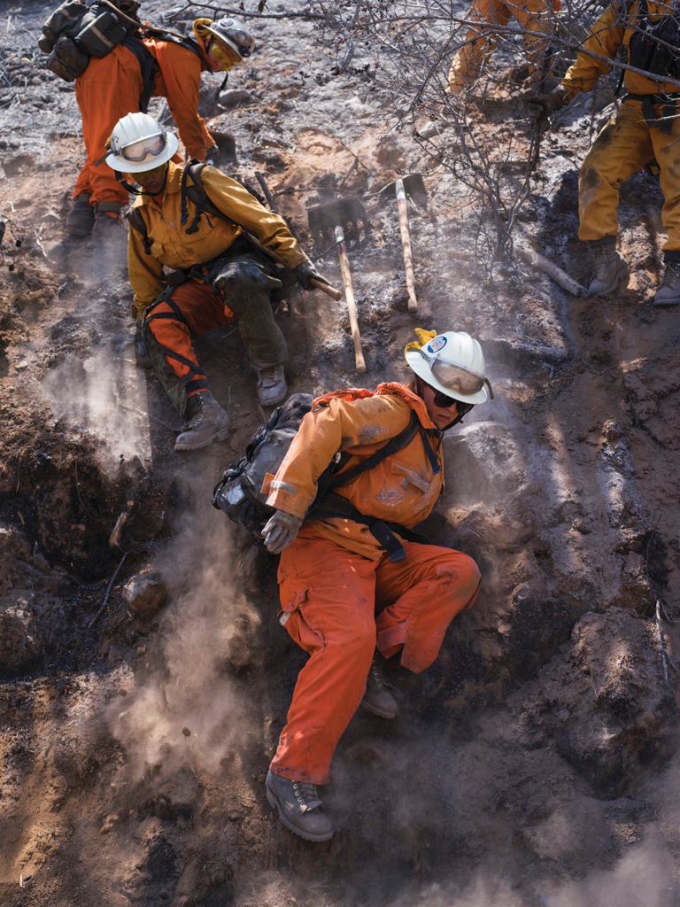 Inmate firefighters navigate difficult terrain building fire breaks in vulnerable wildlands. Photo by Peter Bohler/Redux.